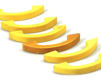Set of six yellow plastic pulls