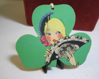 Gorgeous unused die cut art deco 1920's pop out St. Patrick's Day Buzza bridge tally card pretty blonde w/black lace fan inside green clover