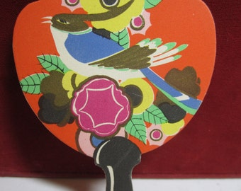 1920's art deco die cut unused Buzza bridge tally card  in shape of miniature fan colorful tropical bird sitting on deco flowers