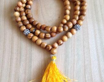 Boho luxe long wood bead and rhinestone tassel necklace marigold