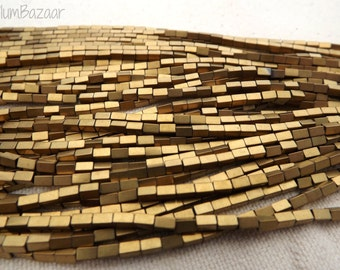 Hematite beads, 4mmx 2mm rectangles, matte gold, two 11 inch strands