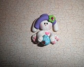 Polymer Clay Easter Bunny- Easter Bunny Holding a Easter Egg and Wearing a Hat Bow Center/Pin/Magnet/Badge/Gift