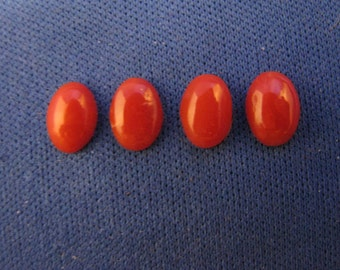 Four 8mm x 6mm Oval Red Coral Cabochons