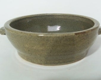 Hand thrown Stoneware small baking dish, with celadon green glaze.