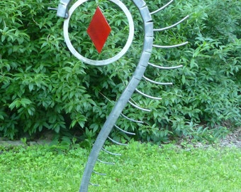 Outdoor abstract rock and metal scultpure, yard art or interior art