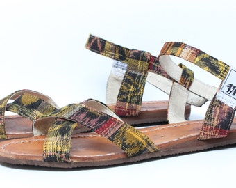 Andaslo handmade crossed strap sandals