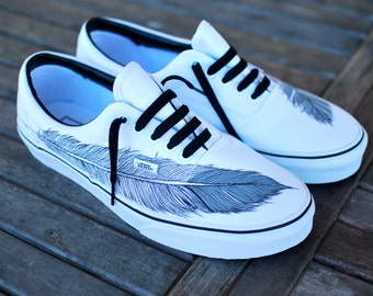 vans with lightning bolt. hand painted native eagle feather on white vans era shoes with lightning bolt
