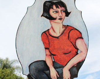 Seated woman- painted on wood