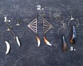 white wolf teeth hoop earrings/ antiqued buffalo, silver hoop earrings/ Raw brass pyramid, antiqued wolf tooth dangle earrings.