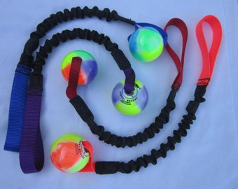 Tug toy with bungee and street hockey ball