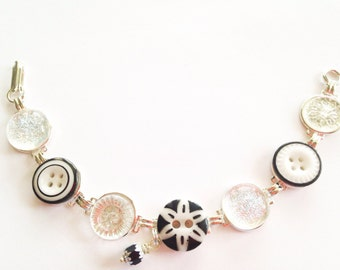 Antique button bracelet. BLACK & WHITE, carved mother of pearl shell and glass buttons, silver links