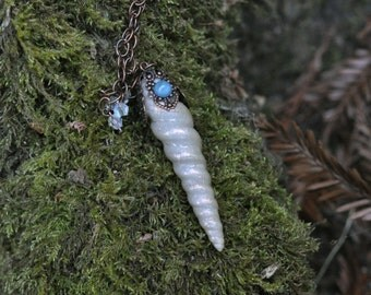 unicorn horn necklace with blue moonstone on front