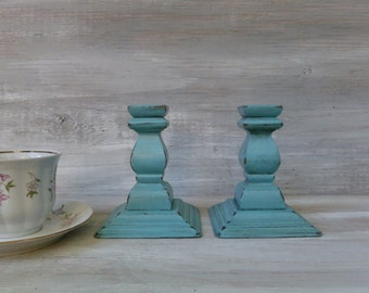 Pair of Turquoise Chippy Painted Candlesticks