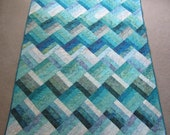 PDF Pattern Ocean Rail Fence Waves twin and queen sized quilt is easy and fun, made from medium, dark, and light batiks in green blue purple