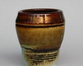 Stunning rusty ochre porcelain cup.