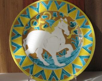 Decorated and engraved Maiolica Ceramic Plate measuring 21 cm in diameter