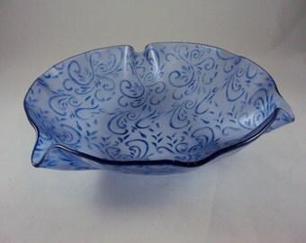 blue on blue-violet wallpaper patterned round stenciled glass bowl