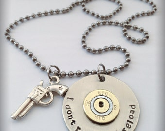 Hand stamped I don't retreat I reload pendent necklace. authentic spent 410 shot gun shell casing riveted to a silver tag
