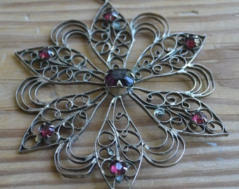 Beautiful antique silver tone edwardian art deco flower pendant with purple amethyst pastes