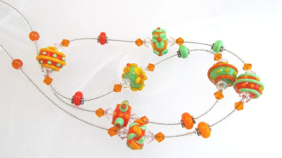 Necklace orange and green glass lampwork beads, crystals and glass beads, about 23""
