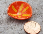 Miniature Bright Orange Triangle Shaped Bowl with a Bright Yellow Starburst