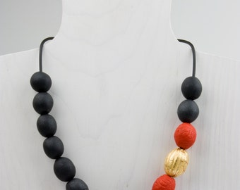 Black, red and gold polymer bead necklace