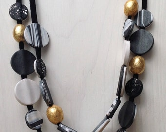 Gold black and white versatile necklace