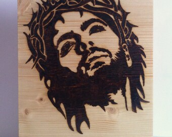 Jesus with fire wood pyrography