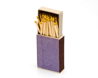 Matchbox, wooden matches with yellow heads inside, striker from two sides