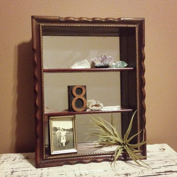 wooden shadow box shelf with mirrored background