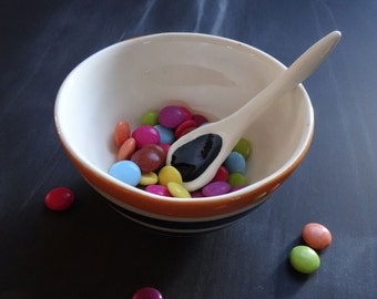Black and orange stripe ceramic bowl