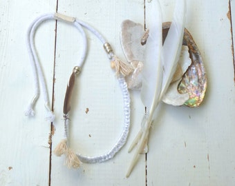 the kindness of doves #4 hand knotted and sewn rope necklace with feather, tassels and beads.  Individual no. 4