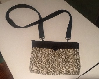 Cute Daytime Herringone style Purse with long strap, zippered closure, and inside pockets