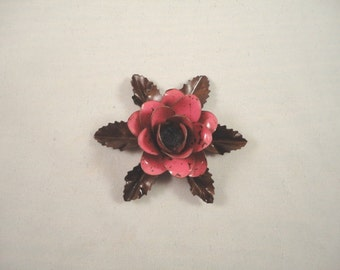 Small Size Decorative Metal Hand Cut and Hand Painted Rustic Dark Pink Color Rose Mounted on a Bed of Leaves.