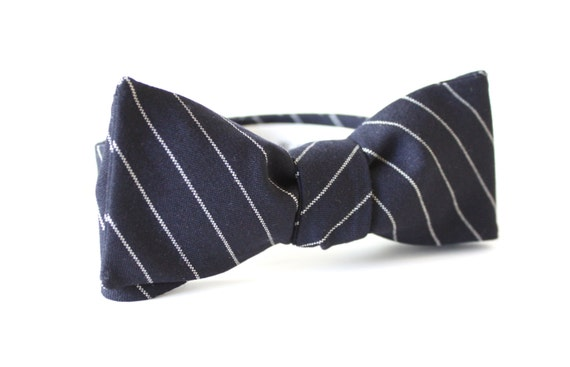 Navy Blue Bow tie White Star Bow tie Navy Blue Cotton by DamDamu. Find this Pin and more on Little Gent's by DamDamu. Navy Blue Bow tie Polka Dot Bow tie Navy Blue Cotton by DamDamu See more. Men's Bow Tie, classic navy blue and white polka dots, Winston Churchill bow tie, wedding bow tie, groom bow tie, traditional navy bow tie.