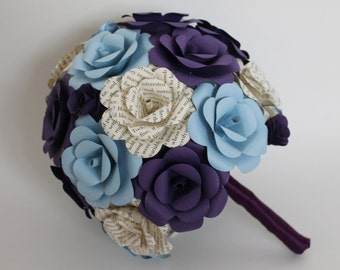 Book pages, purple, and blue paper flower bouquet