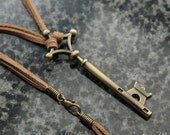 Attack on Titan necklace – Eren Yeager's metal basement key on a double leather cord – Titan key cosplay prop replica