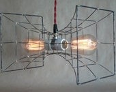 Siren Hanging Light, caged pendant light; made from steel and brass with a double ceramic socket and 2 Edison bulbs