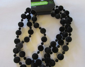 Black felted beads