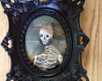Morbid cameo of departed loved one ready to adorn your home for Halloween.
