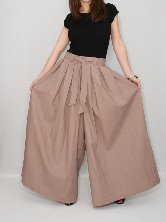 Crepe Wide Leg Pants: Crafted from softly textured stretch crepe, these wide leg pants are relaxed through the hip and thigh for figure flattery and comfort. Fully lined for exceptional quality, these pants feature front darts, a fly front with double hook closure, belt .