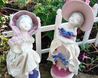 Porcelain Figurines with Bonnet and Bows and Shawl with Hood