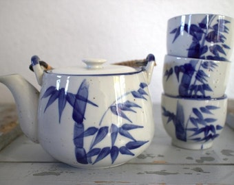 Asian teapot with 3 cups