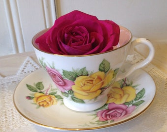 Vintage Harlequin Pink and Yellow Rose Teacup and saucer in English Bone China.