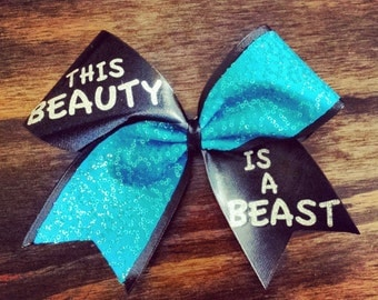 Turquoise this beauty is a beast cheer bow.