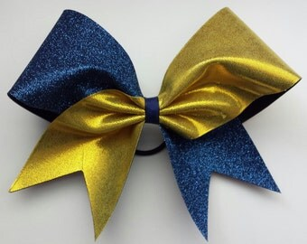 Navy blue and gold cheer bow