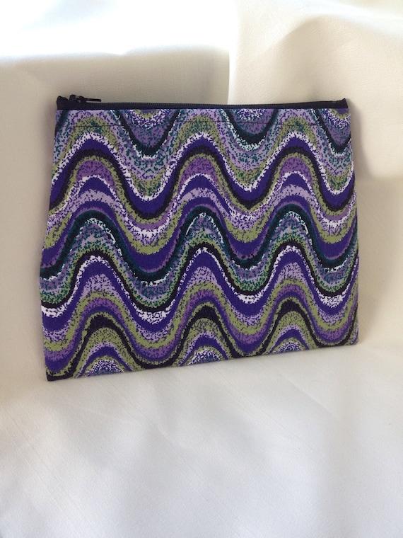 purple and green swirl clutch or make up bag. Black Bedroom Furniture Sets. Home Design Ideas