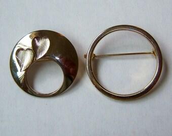 Set Of Circle Pins. Silver Tone. Gold Tone. One Plain. One Leaf Design.