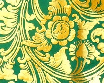 fabric from the roll in green-gold Bali design bordure on both sides