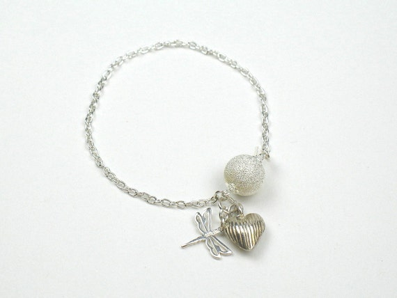 Charm Bracelet in Sterling Silver with Silver Heart and Dragon Fly Charms on a Silver Chain and Silver Stardust Ball Clasp